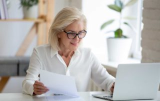 older woman using laptop computer for research