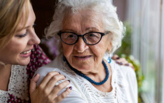 elderly mother and daughter sharing comforting moment