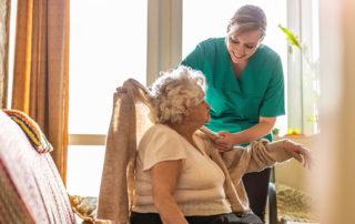 Nurse helps patient in nursing home